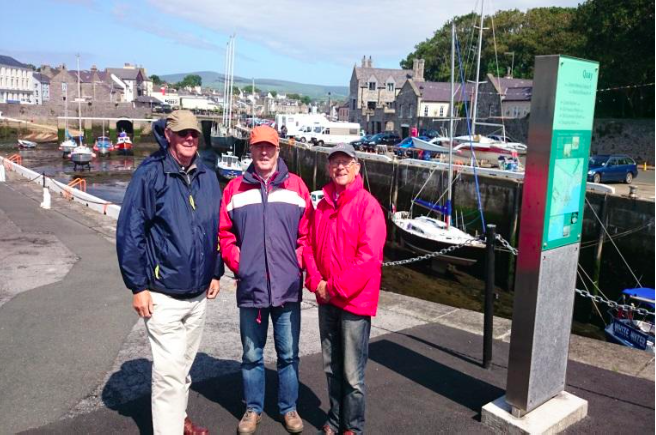 Three happy tourists in Castletown, south of IoM.